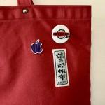 Apple京都のオリジナルピンパッジを信三郎帆布に